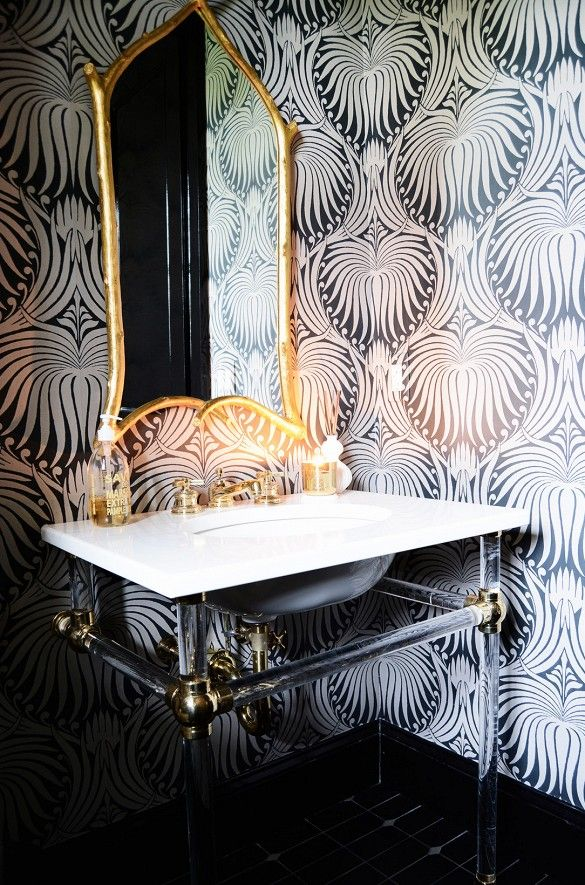 French style at its best with black and white oversell pattern with an ornate gold mirror.