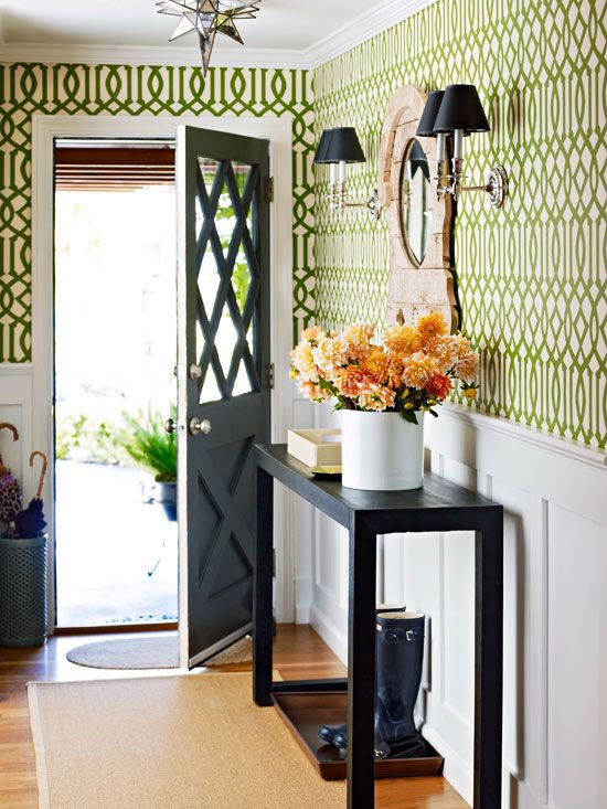 This parrot green fretwork paper add a welcoming touch to an entry.