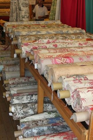 Traditional bolts of French fabrics.
